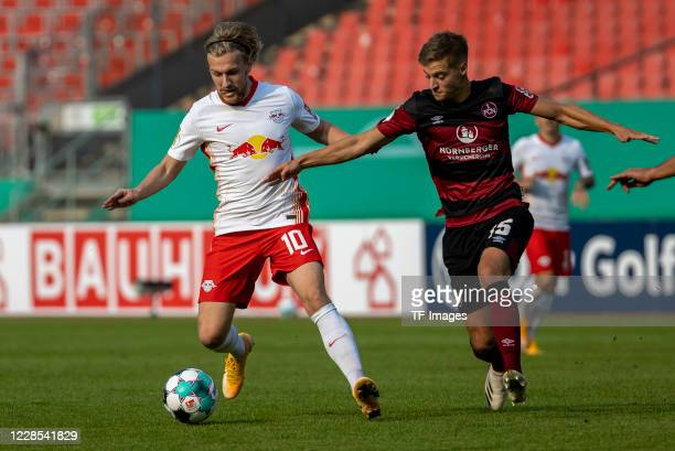 Emil Forsberg of RB Leipzig and Fabian Nuernberger of 1FC Nuernberg during the DFB Cup first round match between 1 FC Nuernberg and RB Leipzig at...