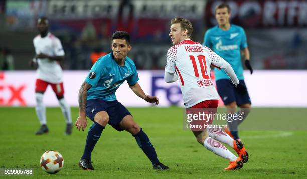 Emil Forsberg of RB Leipzig and Matias Kranevitter of FC Zenit Saint Petersburg compete during the UEFA Europa League Round of 16 match between RB...
