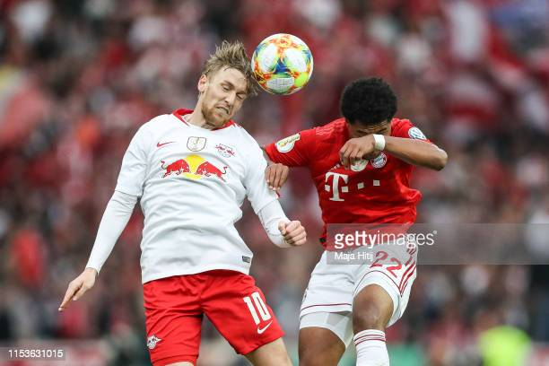 Emil Forsberg of RB Leipzig and Serge Gnabry of Bayern Munich battle for possession during the DFB Cup final between RB Leipzig and Bayern Muenchen...