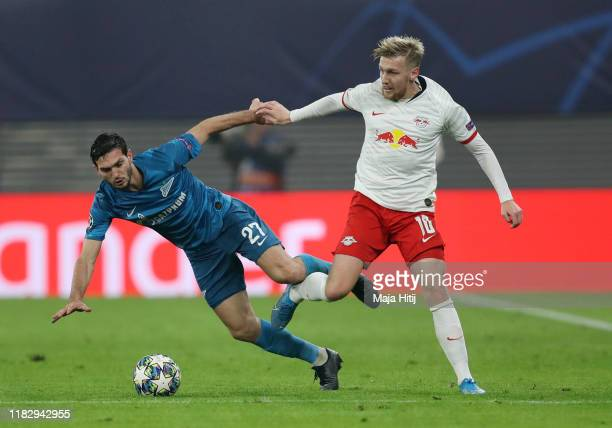 Emil Forsberg of RB Leipzig battles for possession with Magomed Ozdoev of Zenit St. Petersburg during the UEFA Champions League group G match between...