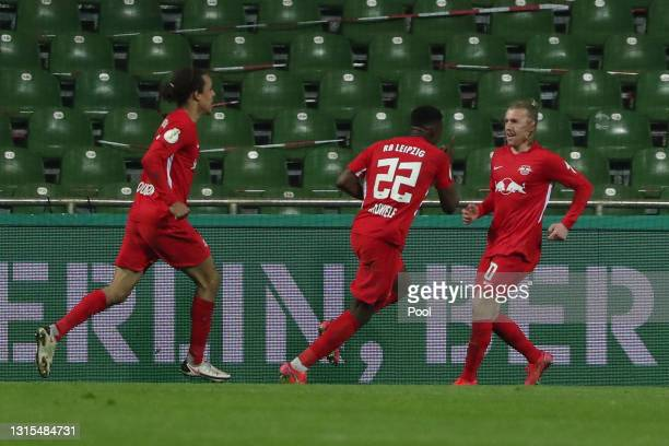 Emil Forsberg of RB Leipzig celebrates with team mate Nordi Mukiele after scoring his team's second goal during the DFB Cup semi final match between...