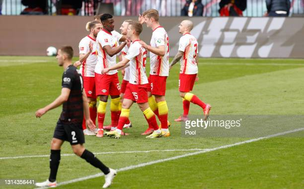 Emil Forsberg of RB Leipzig celebrates with team mates after scoring their side's second goal during the Bundesliga match between RB Leipzig and VfB...
