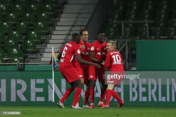 Emil Forsberg of RB Leipzig celebrates with team mates Nordi Mukiele, Yussuf Poulsen and Ibrahima Konate after scoring his team's second goal during...