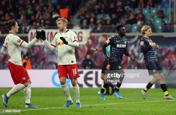 Emil Forsberg of RB Leipzig celebrates with teammate Marcel Sabitzer after scoring his team's second goal during the Bundesliga match between RB...