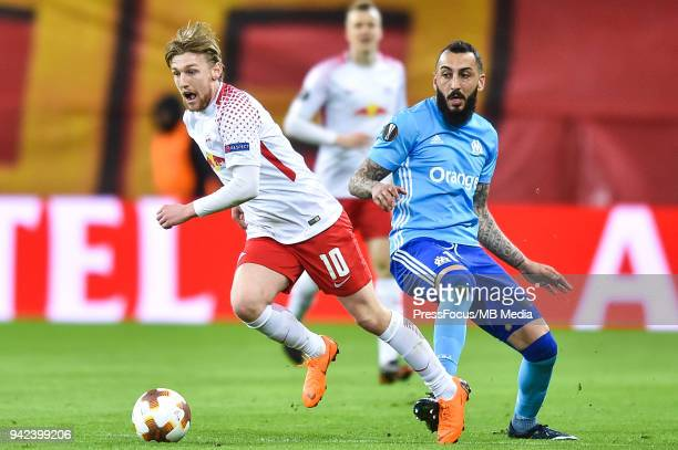 Emil Forsberg of RB Leipzig competes with Kostas Mitroglou of Olympique Marseille during the UEFA Europa League quarter final leg one match between...