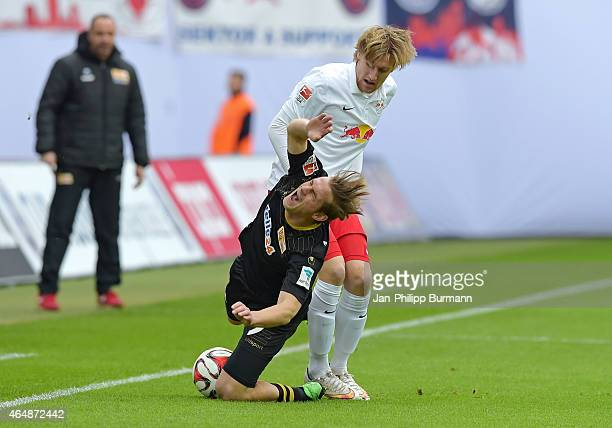 Emil Forsberg of RB Leipzig foults Soeren Brandy of 1FC Union Berlin during the game between RB Leipzig and 1 FC Union Berlin on March 1 2015 in...