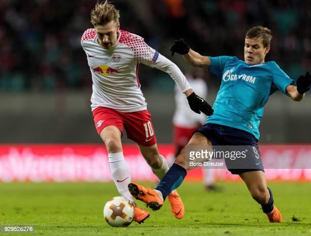 Emil Forsberg of RB Leipzig is challenged by Aleksandr Kokorin of Zenit St Petersburg during UEFA Europa League Round of 16 match between RB Leipzig...