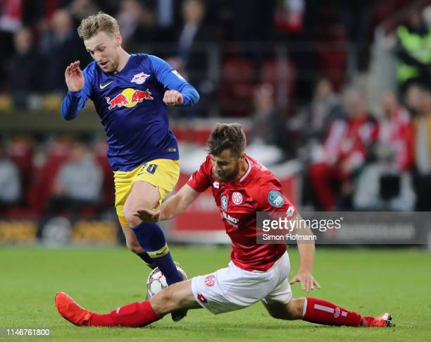 Emil Forsberg of RB Leipzig is challenged by Alexander Hack of FSV Mainz during the Bundesliga match between 1 FSV Mainz 05 and RB Leipzig at Opel...