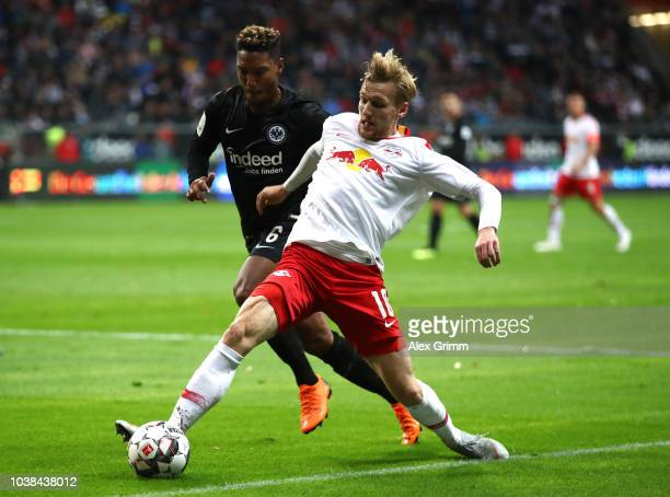 Emil Forsberg of RB Leipzig is challenged by Jonathan De Guzman of Eintracht Frankfurt during the Bundesliga match between Eintracht Frankfurt and RB...