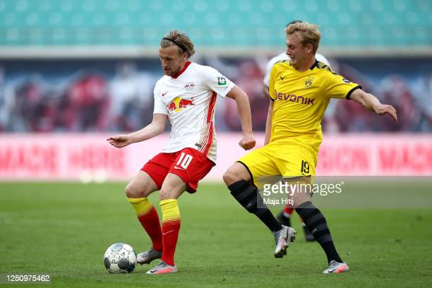 Emil Forsberg of RB Leipzig is challenged by Julian Brandt of Borussia Dortmund during the Bundesliga match between RB Leipzig and Borussia Dortmund...