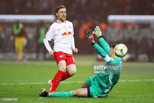 Emil Forsberg of RB Leipzig is challenged by Manuel Neuer of Bayern Munich during the DFB Cup final between RB Leipzig and Bayern Muenchen at...