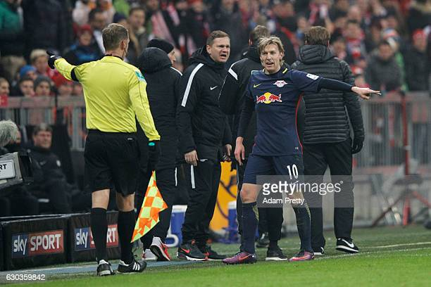Emil Forsberg of RB Leipzig reacts to being sent off during the Bundesliga match between Bayern Muenchen and RB Leipzig at Allianz Arena on December...