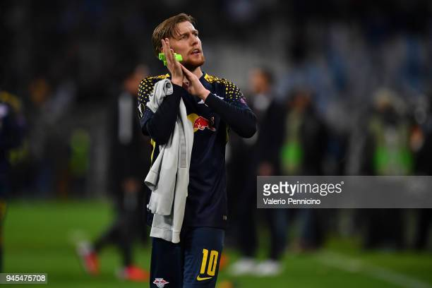 Emil Forsberg of RB Leipzig salutes the fans at the end of the UEFA Europa League quarter final leg two match between Olympique Marseille and RB...
