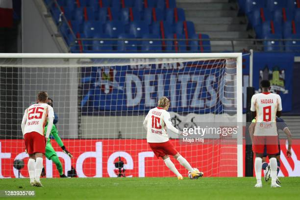 Emil Forsberg of RB Leipzig scores his sides second goal from the penalty spot during the UEFA Champions League Group H stage match between RB...
