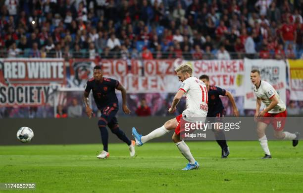 Emil Forsberg of RB Leipzig scores his team's first goal from a penalty during the Bundesliga match between RB Leipzig and FC Bayern Muenchen at Red...