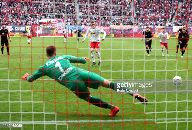 Emil Forsberg of RB Leipzig scores his team's second goal from the penalty spot during the Bundesliga match between RB Leipzig and SportClub Freiburg...