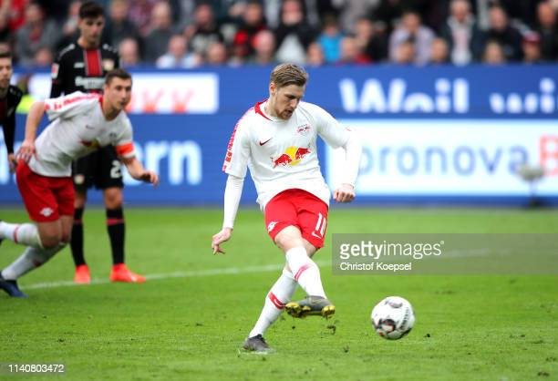 Emil Forsberg of RB Leipzig scores his team's third goal during the Bundesliga match between Bayer 04 Leverkusen and RB Leipzig at BayArena on April...