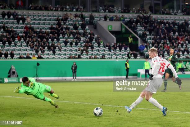 Emil Forsberg of RB Leipzig scores his team's third goal past Pavao Pervan of VfL Wolfsburg during the DFB Cup second round match between VfL...