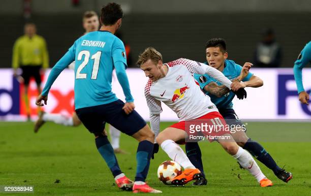 Emil Forsberg of RB Leipzig vies with Aleksandr Erokhin and Matas Kranevitter of FC Zenit Saint Petersburg during the UEFA Europa League Round of 16...