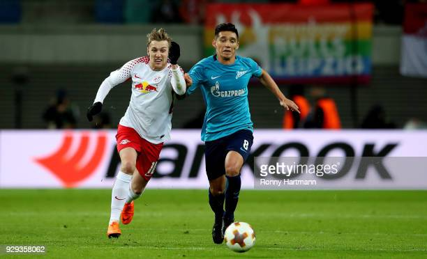 Emil Forsberg of RB Leipzig vies with Matas Kranevitter of FC Zenit Saint Petersburg during the UEFA Europa League Round of 16 match between RB...