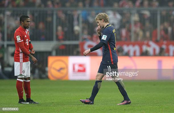 Emil Forsberg of RB Leipzig walks off after being sent off during the Bundesliga match between Bayern Muenchen and RB Leipzig at Allianz Arena on...