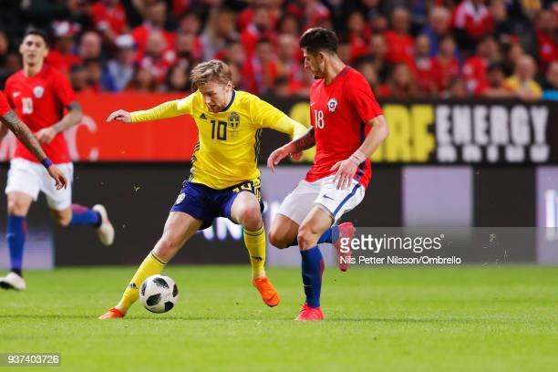 Emil Forsberg of Sweden and Angelo Sagal of Chile competes for the ball during the International Friendly match between Sweden and Chile at Friends...