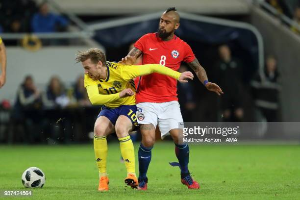 Emil Forsberg of Sweden and Arturo Vidal of Chile during the International Friendly match between Sweden and Chile at Friends arena on March 24 2018...
