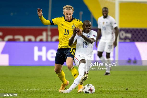 Emil Forsberg of Sweden and N'Golo Kanté of France during the UEFA Nations League group stage match between Sweden and France at Friends Arena on...