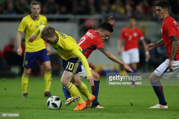 Emil Forsberg of Sweden and Pedro Pablo Hernandez of Chile during the International Friendly match between Sweden and Chile at Friends arena on March...