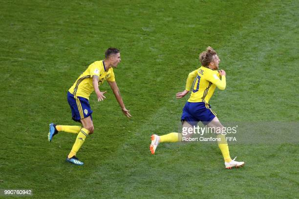 Emil Forsberg of Sweden celebrates with team mate Mikael Lustig after scoring his team's first goal with team mates during the 2018 FIFA World Cup...