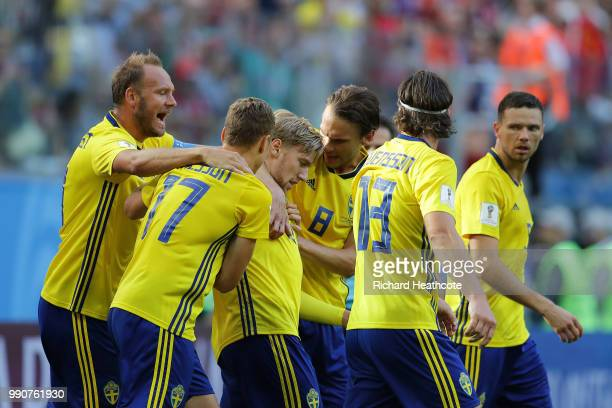 Emil Forsberg of Sweden celebrates with teammates after scoring his team's first goal during the 2018 FIFA World Cup Russia Round of 16 match between...