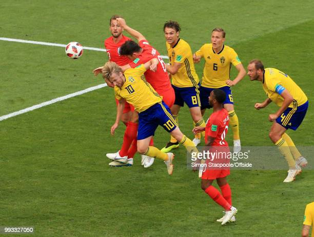 Emil Forsberg of Sweden is beaten to the ball by Harry Maguire of England who heads the opening goal during the 2018 FIFA World Cup Russia Quarter...