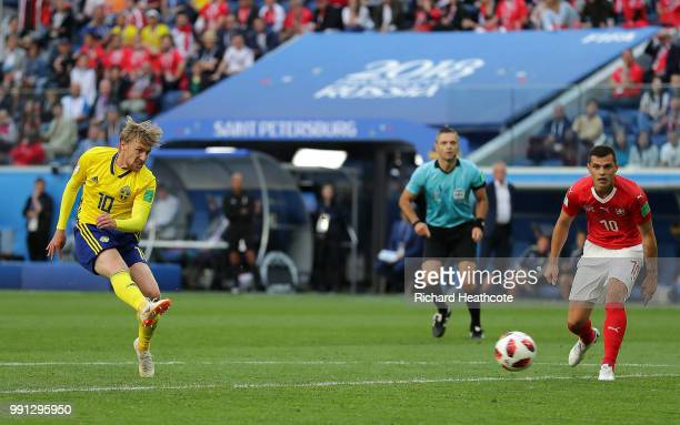 Emil Forsberg of Sweden scores his team's first goal during the 2018 FIFA World Cup Russia Round of 16 match between Sweden and Switzerland at Saint...