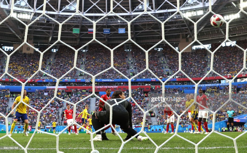 Emil Forsberg of Sweden scores his team's first goal past goalkeeper Yann Sommer of Switzerland during the 2018 FIFA World Cup Russia Round of 16 match between Sweden and Switzerland at Saint Petersburg Stadium on July 3, 2018 in Saint Petersburg, Russia.