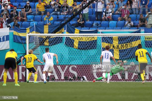 Emil Forsberg of Sweden scores their side's first goal from the penalty spot past Martin Dubravka of Slovakia during the UEFA Euro 2020 Championship...