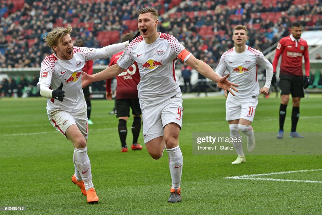 Emil Forsberg, Willi Orban and Timo Werner of Leipzig celebrate their teams second goal during the Bundesliga match between Hannover 96 and RB Leipzig at HDI-Arena on March 31, 2018 in Hanover, Germany.