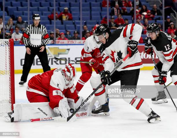 Emil Gransoe of Denmark makes a save on a shot form Drake Batherson of Canada during the first period of play in the IIHF World Junior Championships...