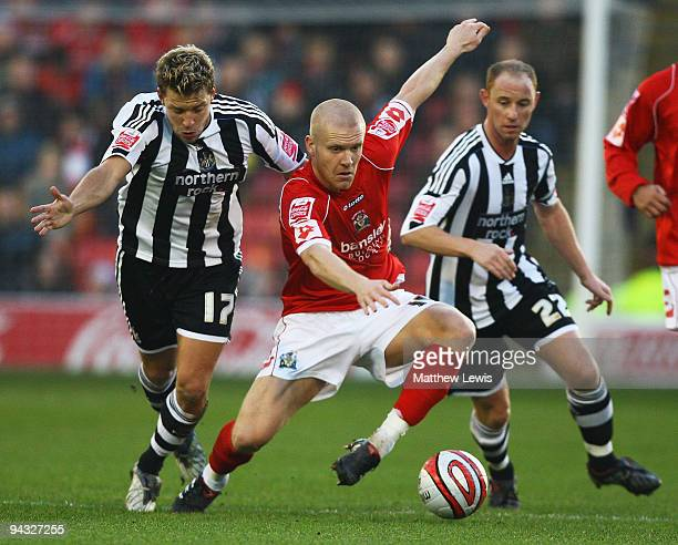 Emil Hallfredsson of Barnsley holds off Alan Smith of Newcastle during the CocaCola Championship match between Barnsley and Newcastle United at...