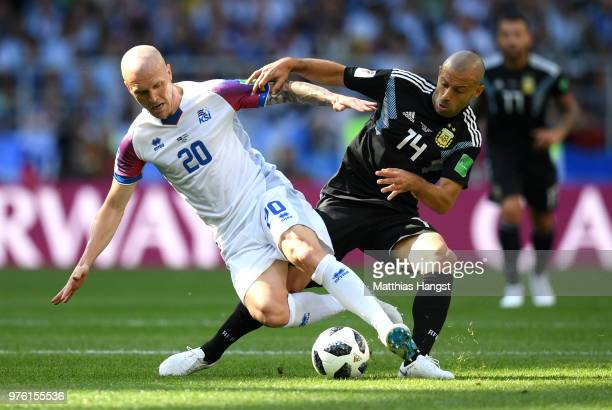 Emil Hallfredsson of Iceland and Javier Mascherano of Argentina battle for possession during the 2018 FIFA World Cup Russia group D match between...