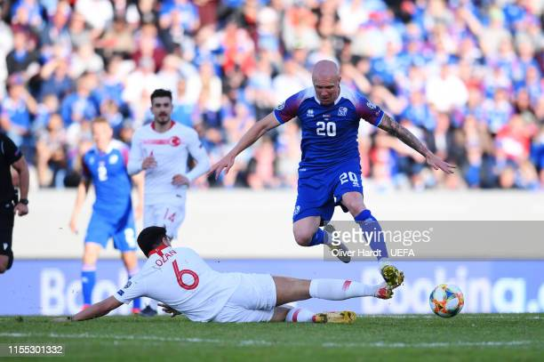 Emil Hallfredsson of Iceland challenges for the ball with Ozan Tufan of Turkey during the UEFA Euro 2020 Qualifier match between Iceland and Turkey...