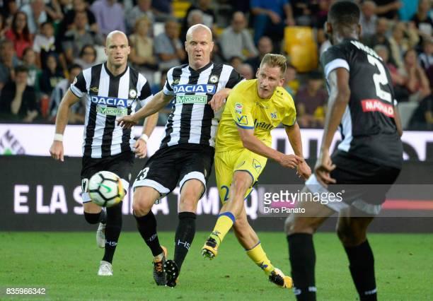 Emil Hallfredsson of Udinese Calcio competes with Valter Birsa of AC Chievo Verona during the Serie A match between Udinese Calcio and AC Chievo...