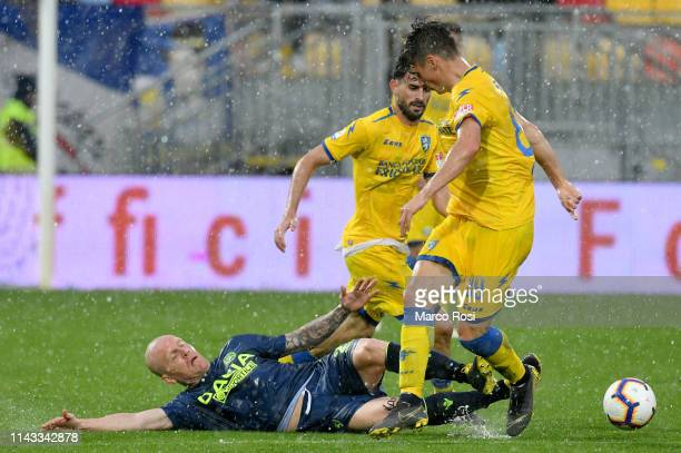 Emil Hallfredsson of Udinese compete for the ball with Luca Paganini of Frosinone during the Serie A match between Frosinone Calcio and Udinese at...