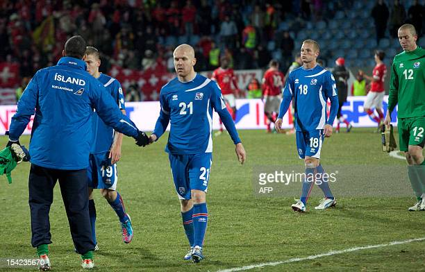 Emil Hallfreosson of Iceland leaves the pitch after the FIFA World Cup 2014 qualifying football match Iceland vs Switzerland in Reykjavik on October...