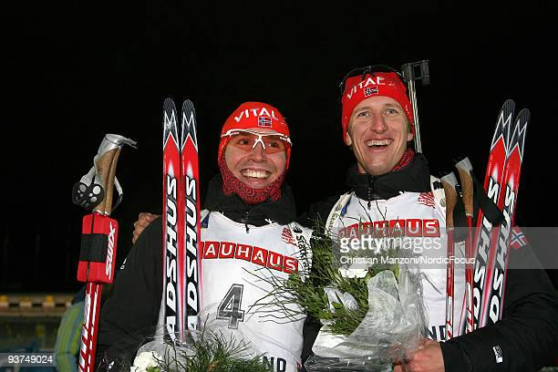 Emil Hegle Svendsen of Norway and Lars Berger of Norway smile after the Men's 20 km Individual event in the EON Ruhrgas IBU Biathlon World Cup on...