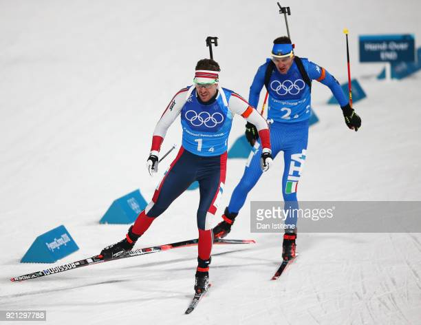 Emil Hegle Svendsen of Norway and Lukas Hofer of Italy compete during the Biathlon 2x6km Women 2x75km Men Mixed Relay on day 11 of the PyeongChang...