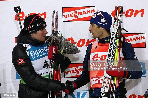 Emil Hegle Svendsen of Norway and Martin Fourcade of France shake hands during the IBU Biathlon World Championships Men's 15km Mass Start on March 12...