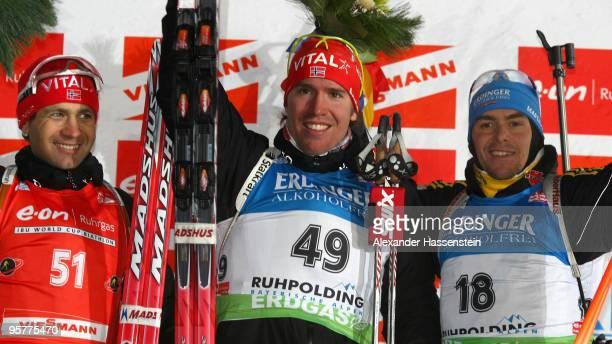 Emil Hegle Svendsen of Norway celebrates after winning the Men's 10km Sprint in the e.on Ruhrgas IBU Biathlon World Cup ahead of Ole Einar...