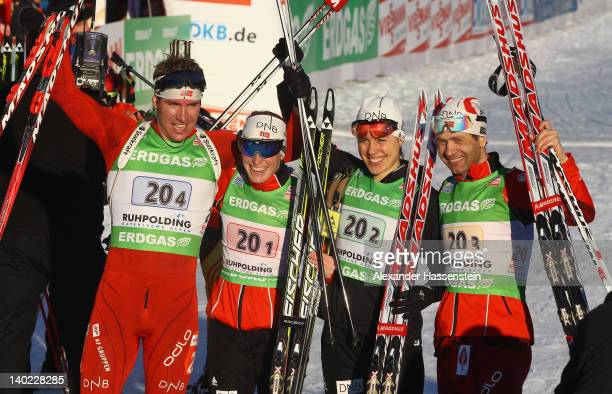 Emil Hegle Svendsen of Norway celebrates at the finish area with his team mates Tora Berger Synnoeve Solemdal and OleEinar Bjoerndalen after the IBU...