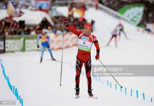 Emil Hegle Svendsen of Norway celebrates during the men's mass start in the e.on Ruhrgas IBU Biathlon World Cup on January 16, 2010 in Ruhpolding,...