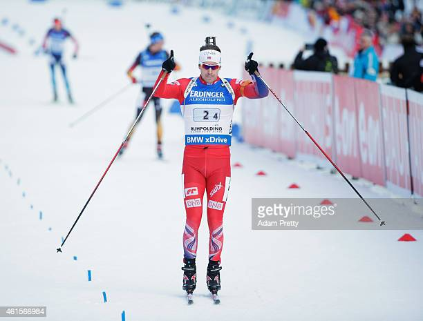Emil Hegle Svendsen of Norway celebrates victory as he crosses the finish line after the IBU Biathlon World Cup Men's Relay on January 15, 2015 in...